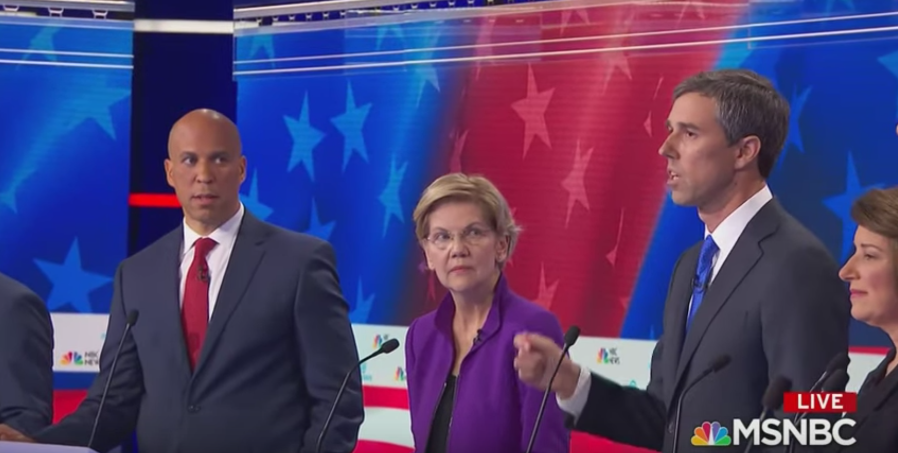 Corey Booker giving Beto the side-eye as the latter got to speak terribly in Spanish before the former